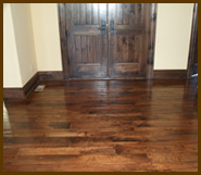 We provide professional hardwood floor refinishing to get your floors shining again.