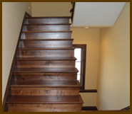 Our hardwood flooring Denver company provides hardwood floor refinishing for staircases.