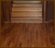 ]: Lovely staircase and hardwood floor refinishing.